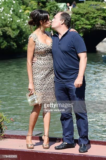 Actress Maria Grazia Cucinotta and Giulio Violati are seen during the 70th Venice International Film Festival on September 4, 2013 in Venice, Italy.