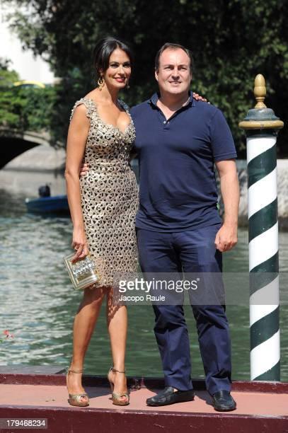 Actress Maria Grazia Cucinotta and husband Giulio Violati are seen during the 70th Venice International Film Festival on September 4, 2013 in Venice,...