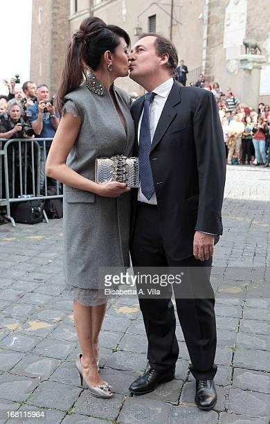 Actress Maria Grazia Cucinotta and husband Giulio Violati arrive at the Valeria Marini And Giovanni Cottone wedding at Ara Coeli on May 5, 2013 in...