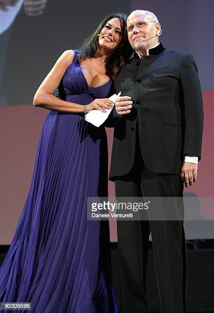 Actress Maria Grazia Cucinotta and Venice Film Festival Director Marco Muller speaks on stage during the Opening Ceremony and Baaria Premiere at the...