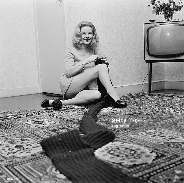 Actress Maria O'Brien knitting a long scarf UK 28th November 1969