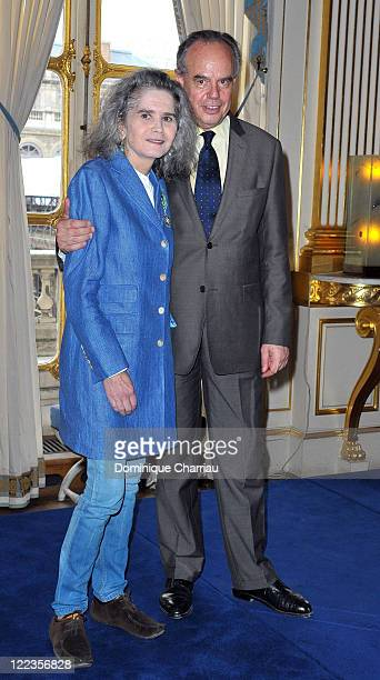 Actress Maria Schneider and Minister of Culture Frederic Mitterrand pose after she receives a medal of Chevalier in the Order of Arts and Letters at...