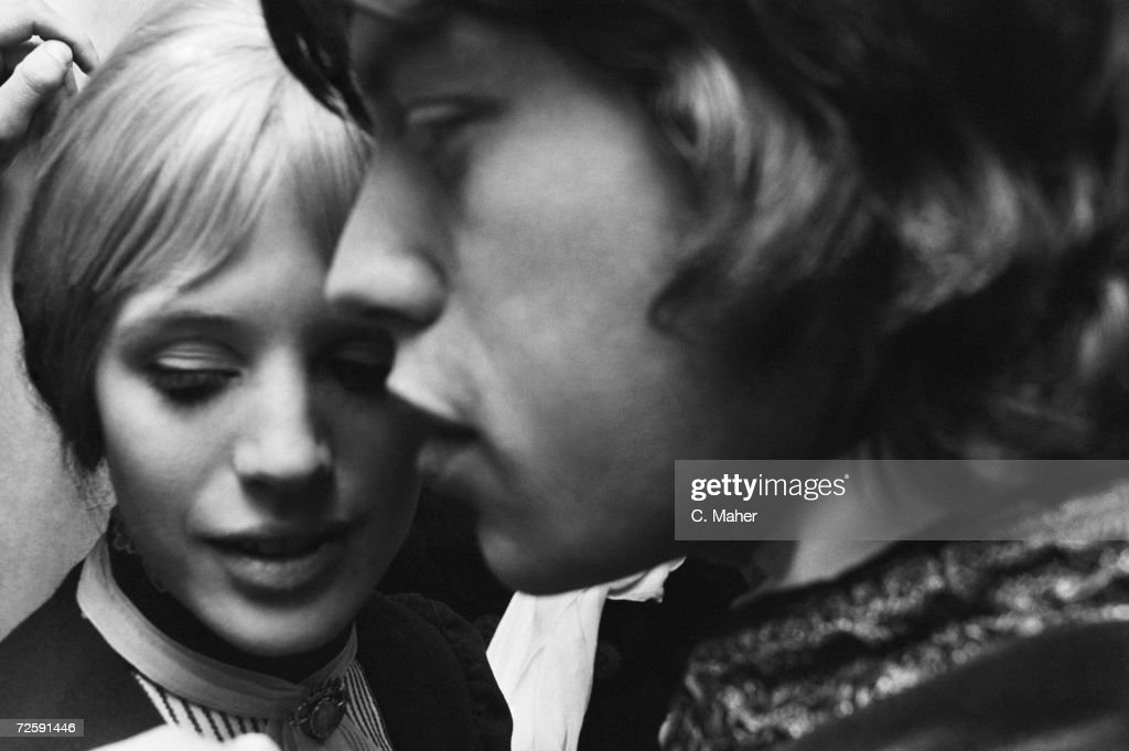 Actress Marianne Faithfull backstage with her boyfriend Mick Jagger after her first night performance as Irina in Chekov's 'The Three Sisters' at the Royal Court theatre in London, 24th April 1967.