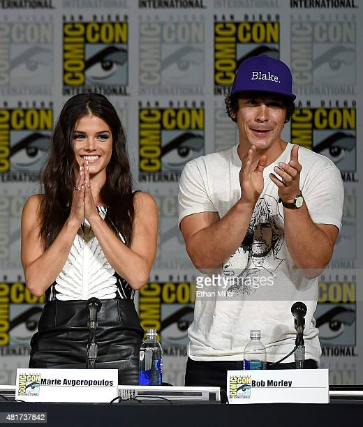 Actress Marie Avgeropoulos and actor Bob Morley attend a special video presentation and panel for The 100 during ComicCon International 2015 at the...