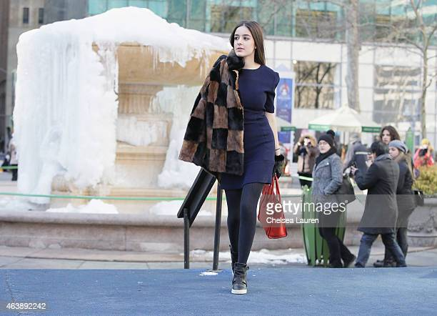 Actress Marie Calfat Nascimento wearing a Charlotte Ronson Fall 2015 navy ribbed washable Tshirt dress with her own vintage mink coat Celine mini...