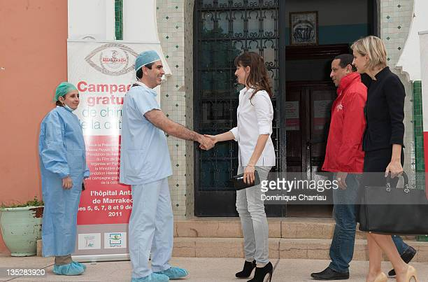 Actress Marie Gillain shakes hands with Dr Omar Berbich during a visit to the Department of Ophthalmology at Marrakech Hospital accompanied by Melita...