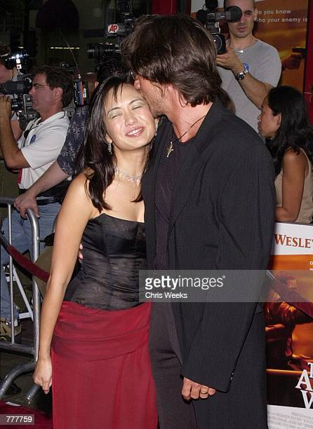 Actress Marie Matiko left and director Christian Duguay share a moment at the premiere of their new film The Art of War August 23 2000 at Mann's...