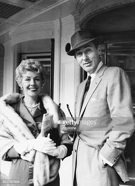 Actress Marie 'The Body' McDonald is greeted by fellow actor Michael Wilding as she arrives at London Airport July 17th 1957