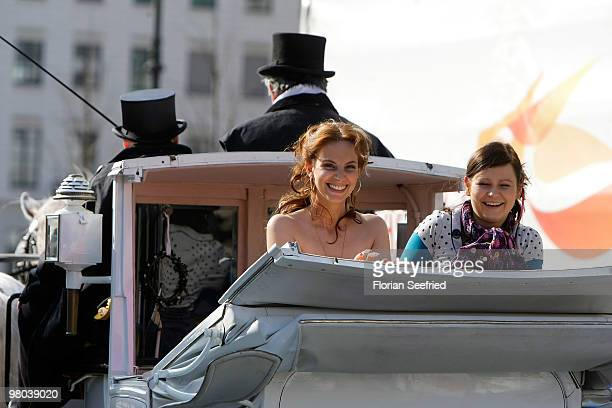 Actress Marie Zielcke and actress Anett Heilfort are seen in a carriage at Unter den Linden during their shooting for the SAT 1 daily soap 'Eine wie...
