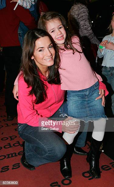 Actress Mariella Ahrens and her daughter Isabella attend the German premiere of Racing Stripes on March 6 2005 in Berlin Germany