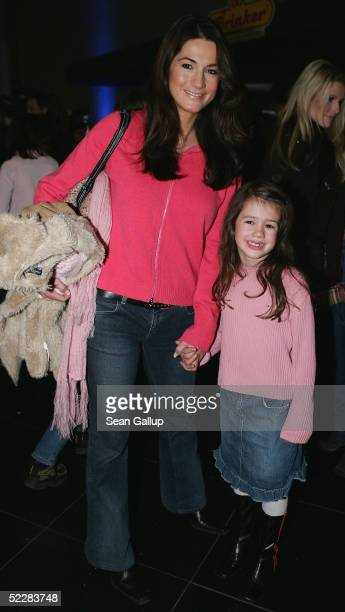 Actress Mariella Ahrens and her sixyearold daughter Isabella attend the German premiere of Racing Stripes on March 6 2005 in Berlin Germany