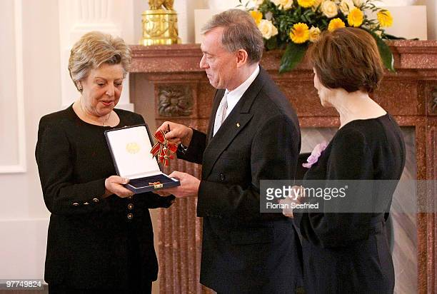 Actress Marie-Luise Marjan receives the Federal Cross Of Merit from German President Horst Koehler and his wife Eva Luise Koehler at Bellevue Castle...