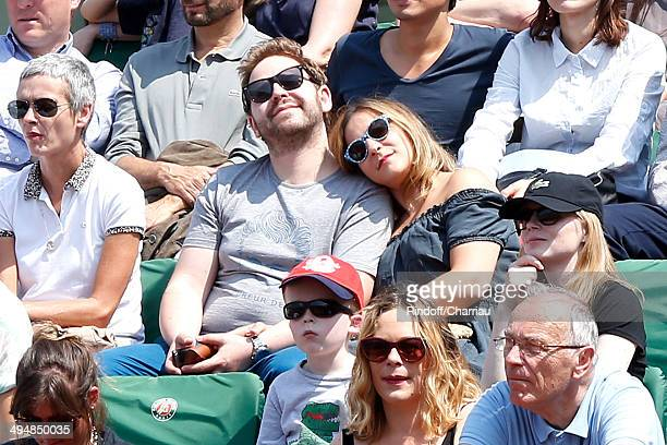 Actress Marilou Berry and her companion Arnaud Schneider attend the Roland Garros French Tennis Open 2014 Day 7 on May 31 2014 in Paris France