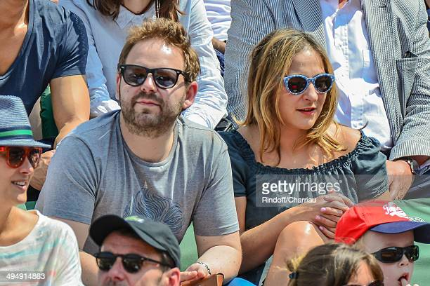 Actress Marilou Berry and her companion Arnaud Schneider attend the Roland Garros French Tennis Open 2014 Day 7 at Roland Garros on May 31 2014 in...