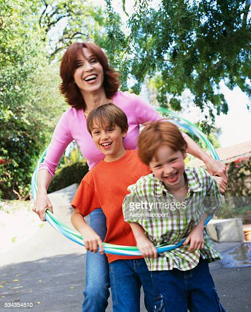 Actress Marilu Henner hula hoops with her sons Nicholas and Joseph