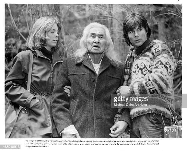 Actress Marilyn Hassett actors Chief Dan George and JanMichael Vincent on set of the movie Shadow of the Hawk circa 1976