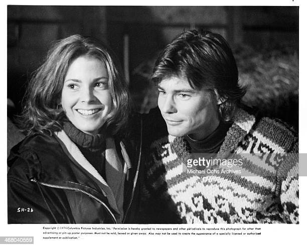 Actress Marilyn Hassett and actor JanMichael Vincent on set of the movie Shadow of the Hawk circa 1976