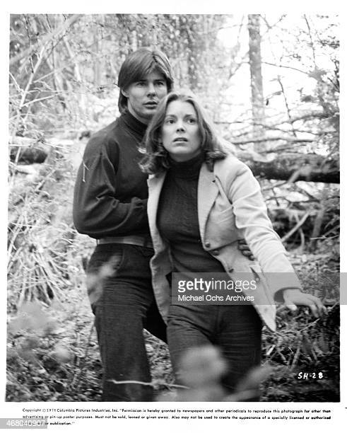 Actress Marilyn Hassett and actor JanMichael Vincent on set of the movie 'Shadow of the Hawk' circa 1976