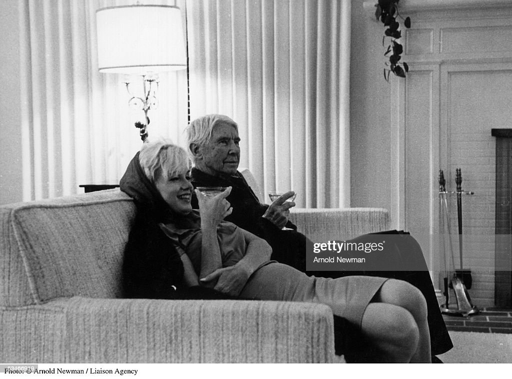 The United States of the Solar System, A.D. 2133 (Book Ten) - Page 32 Actress-marilyn-monroe-and-carl-sandburg-drink-martinis-at-the-home-picture-id53466919