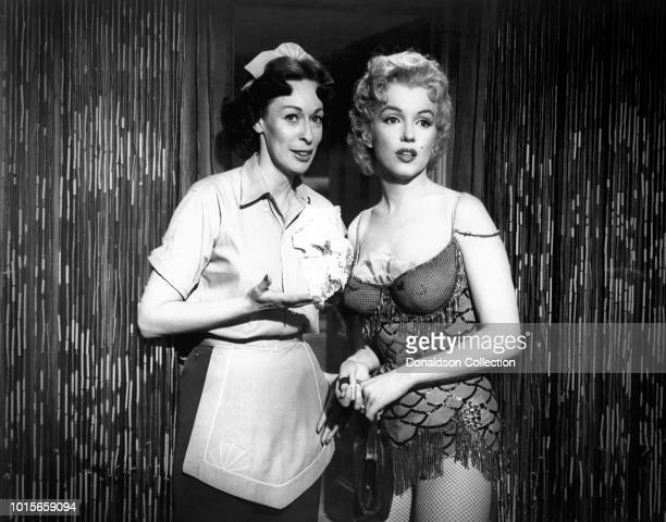 Actress Marilyn Monroe and Helen Reddy in a scene from the 20th Century-Fox film 'Bus Stop' in 1956 in Los Angeles, California. .