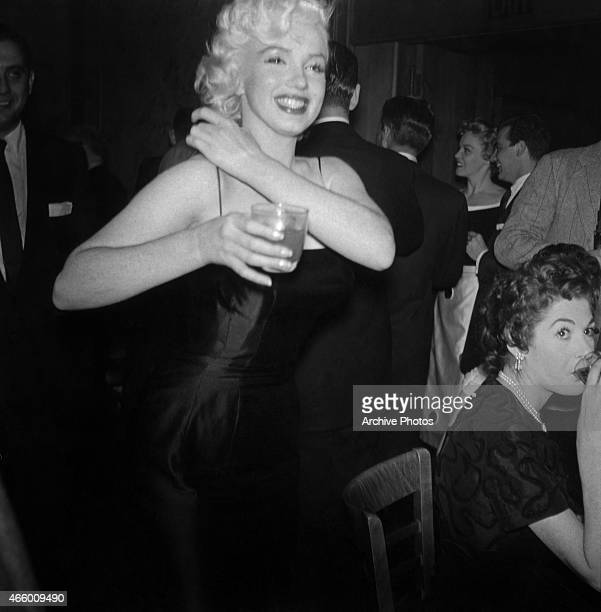 Actress Marilyn Monroe attends Jackie Gleason's birthday party at Toots Shor's Restaurant on February 26 1955 in New York City New York