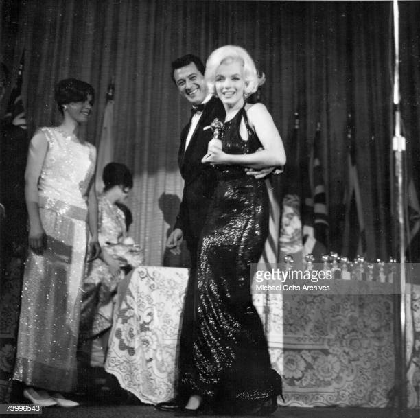 Actress Marilyn Monroe attends the Golden Globe Awards where she won the Henrietta award at the Beverly Hilton Hotel on March 5 1962 in Los Angeles...