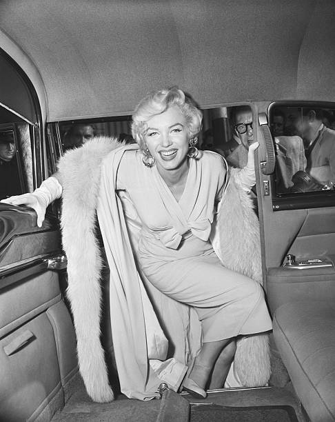 Marilyn Monroe Boarding a Car