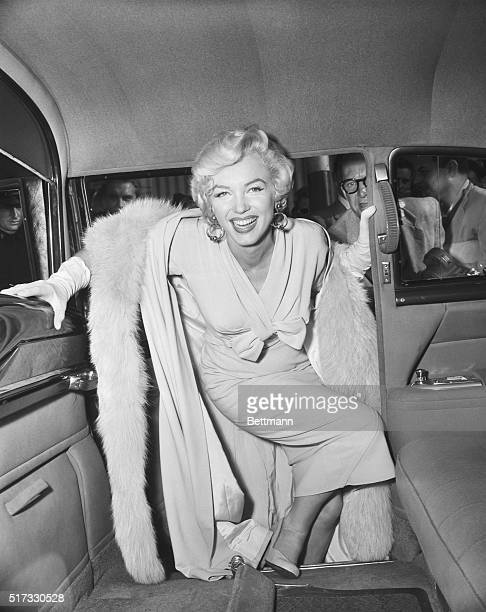 Actress Marilyn Monroe boards a car as she leaves from Idlewild Airport Idlewild Airport is now known as John F Kennedy International Airport
