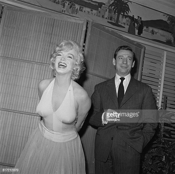 Actress Marilyn Monroe bubbles with glamor during a cocktail party here Jan 15th for her new picture Let's Make Love Released in 1960