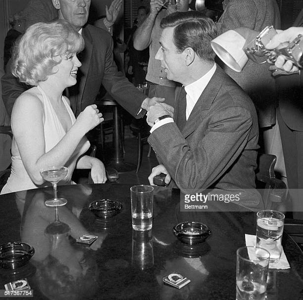 Actress Marilyn Monroe bubbles with glamor during a cocktail party here Jan 15th for her new picture Let's Make Love