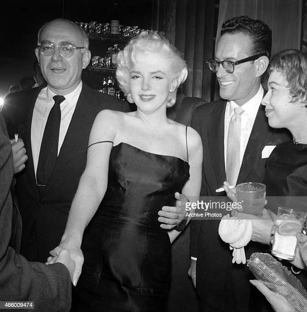 Actress Marilyn Monroe chats with guests at Jackie Gleason's birthday party at Toots Shor's Restaurant on February 26 1955 in New York City New York