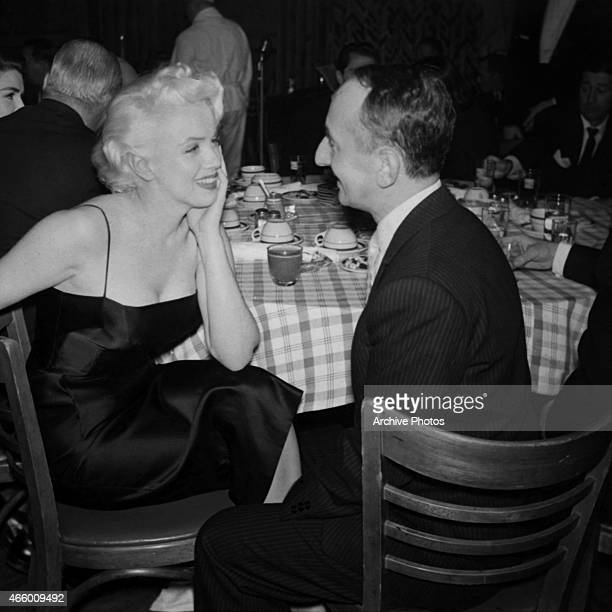 Actress Marilyn Monroe chats with New York Post columnist Leonard Lyons at Jackie Gleason's birthday party at Toots Shor's Restaurant on February 26...