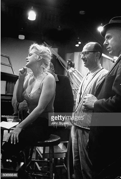Actress Marilyn Monroe clenching her fist as she listens w anxiety to playback of her recording of My Heart Belongs to Daddy song which will be...