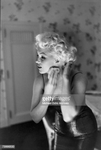 """Actress Marilyn Monroe gets ready to go see the play """"Cat On A Hot Tin Roof"""" playfully applying her make up and Chanel No. 5 Perfume on March 24,..."""