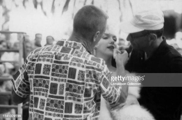 Actress Marilyn Monroe getting makeup applied on the set of Some Like It Hot in 1959 in Los Angeles California