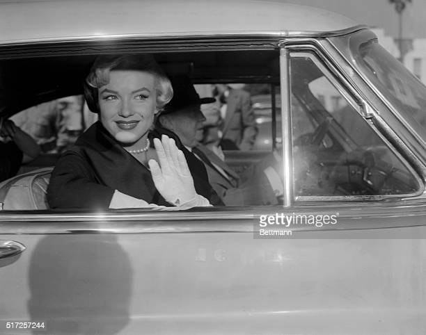 Actress Marilyn Monroe had a smile and a wave for newsmen as she left Superior Court where she obtained a divorce form former baseball player, Joe...