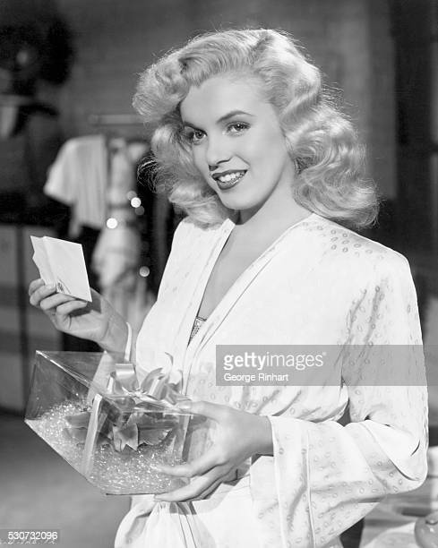 Actress Marilyn Monroe holds a corsage in a box in a scene from the 1948 Columbia Movies production of 'Ladies of the Chorus' Undate movie still