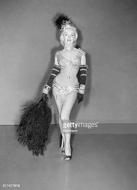 Actress Marilyn Monroe in the headtotoe peekaboo costume she wore for the Jewelers' Association display in New York