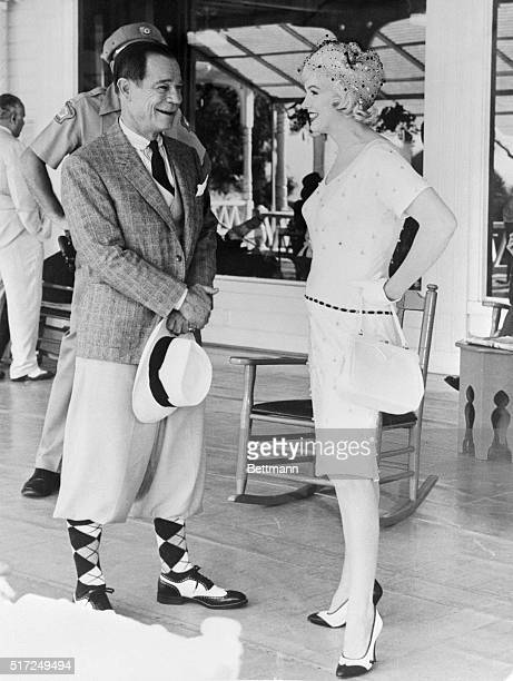 Actress Marilyn Monroe is caught in an unposed shot while chatting with Joe E Brown after she had refused to be bothered by a news photograph...
