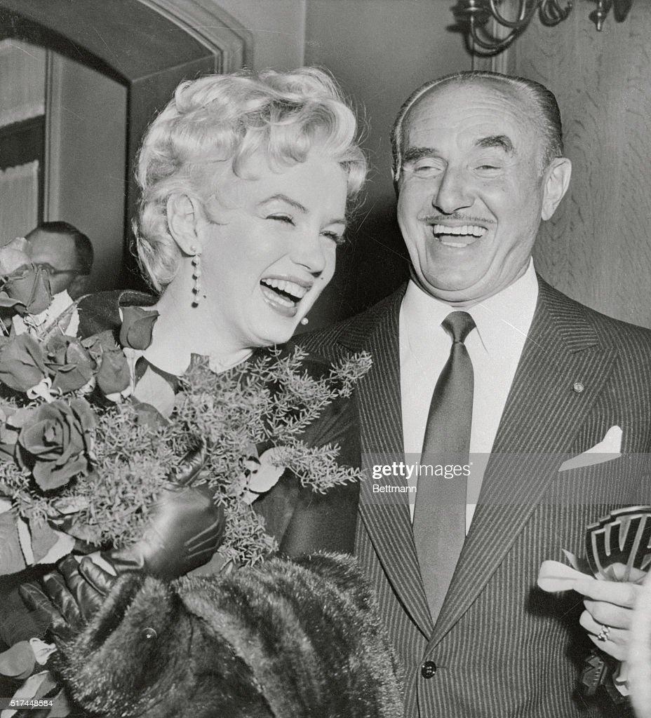 Marilyn Monroe Receiving Flowers From Jack Warner : News Photo
