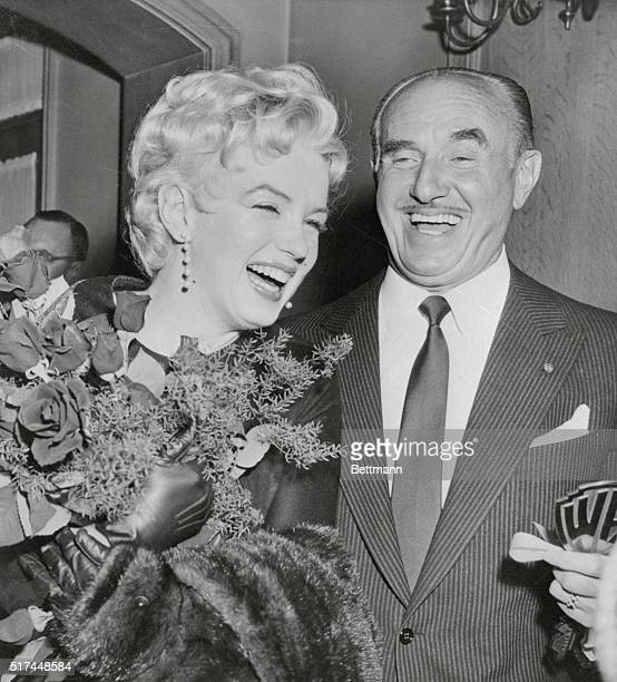 Actress Marilyn Monroe laughs heartily with Jack Warner president of Warner Bros Studios here after Warner announced that Miss Monroe will costar...