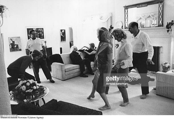 Actress Marilyn Monroe leads conga line during party at producer Henry Weinstein's home January 20 1962 in Hollywood California