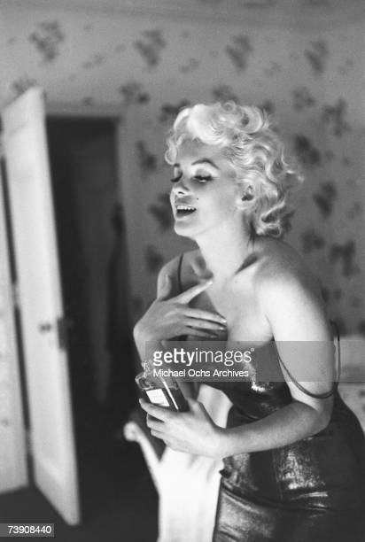 Actress Marilyn Monroe poses for a candid portrait with a bottle of Chanel No 5 perfume on March 24 1955 at the Ambassador Hotel in New York City New...