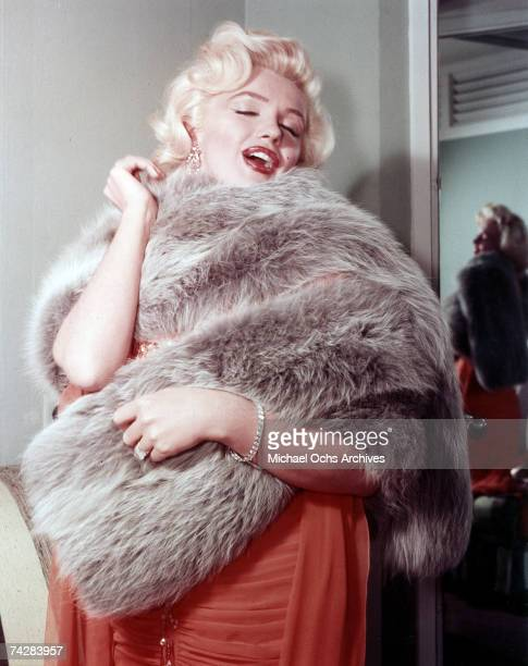 Actress Marilyn Monroe poses for a portrait wearing a fur shawl in circa 1955