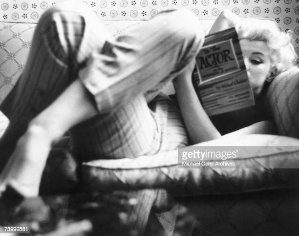 Actress Marilyn Monroe reads the book To the Actor On the Technique of Acting by Michael Chekhov in a quiet moment at the Ambassador Hotel in March...