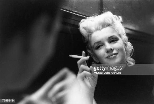 Actress Marilyn Monroe relaxes in a quiet moment in a restaurant in March 1955 in New York City New York