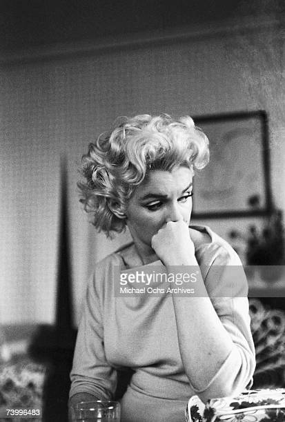 Actress Marilyn Monroe relaxes on a couch in her hotel room at the Ambassador Hotel on March 24 1955 in New York City New York