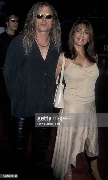 Actress Marina Sirtis and Michael Lamper attending the world premiere of Rockstar on September 4 2001 at Mann Village Theater in Westwood California