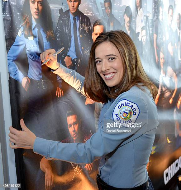 Actress Marina Squerciati signs a poster as she attends a press junket for NBC's 'Chicago Fire' 'Chicago PD' and 'Chicago Med' at Cinespace Chicago...