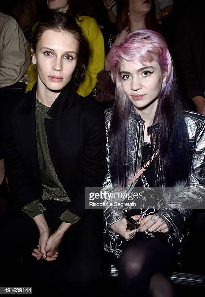 Actress Marine Vacth and musician Grimes attend the Louis Vuitton show as part of the Paris Fashion Week Womenswear Spring/Summer 2016 on October 7...